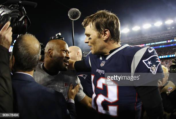 Tom Brady of the New England Patriots celebrates with James Harrison after winning the AFC Championship Game against the Jacksonville Jaguars at...