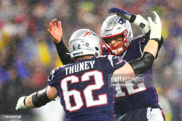 Tom Brady of the New England Patriots celebrates with Joe Thuney of the New England Patriots after a touchdown in the first quarter of a game against...