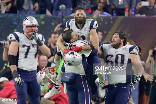 Tom Brady of the New England Patriots celebrates with Julian Edelman after defeating the Atlanta Falcons 34-28 in overtime to win Super Bowl 51 at...