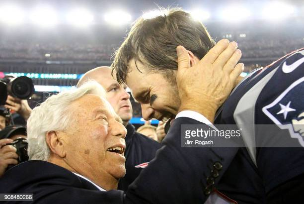 Tom Brady of the New England Patriots celebrates with owner Robert Kraft after winning the AFC Championship Game against the Jacksonville Jaguars at...