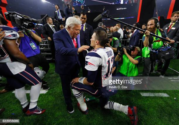 Tom Brady of the New England Patriots celebrates with Patriots owner Robert Kraft after the Patriots defeat the Atlanta Falcons 3428 in overtime of...