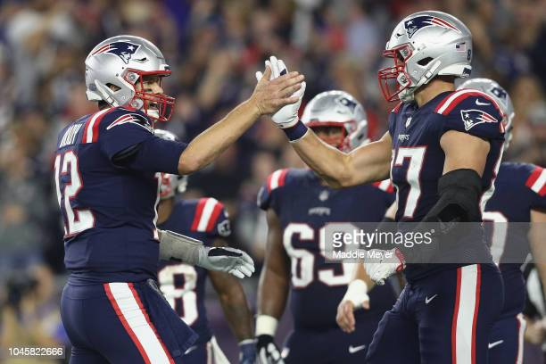 Tom Brady of the New England Patriots celebrates with Rob Gronkowski during the first half against the Indianapolis Colts at Gillette Stadium on...