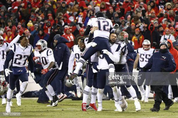 Tom Brady of the New England Patriots celebrates with teammates after defeating the Kansas City Chiefs during the AFC Championship Game at Arrowhead...