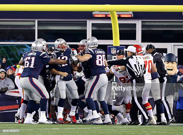 Tom Brady of the New England Patriots celebrates with teammates after scoring a second quarter touchdown against the Kansas City Chiefs during the...