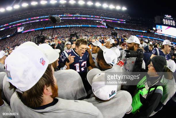 Tom Brady of the New England Patriots celebrates with teammates after winning the AFC Championship Game against the Jacksonville Jaguars at Gillette...