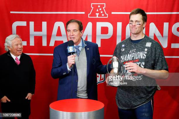 Tom Brady of the New England Patriots celebrates with the Lamar Hunt Trophy after defeating the Kansas City Chiefs in overtime during the AFC...
