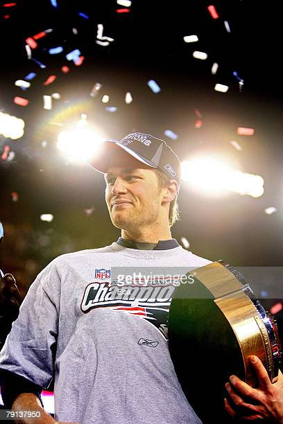 Tom Brady of the New England Patriots celebrates with the Lamar Hunt Trophy after defeating the San Diego Chargers by a score of 2112 to win the AFC...