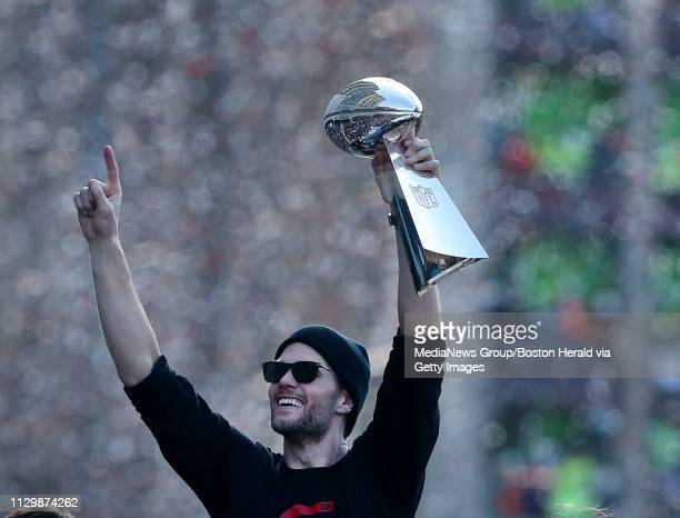 Tom Brady of the New England Patriots celebrates with the Lombardi trophy during the team victory parade after winning Super Bowl LIII on February 5...