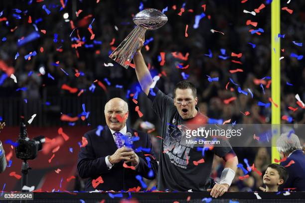 Tom Brady of the New England Patriots celebrates with the Vince Lombardi Trophy after defeating the Atlanta Falcons 3428 in overtime to win Super...