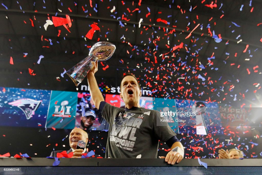 Tom Brady #12 of the New England Patriots celebrates with the Vince Lombardi Trophy after defeating the Atlanta Falcons during Super Bowl 51 at NRG Stadium on February 5, 2017 in Houston, Texas. The Patriots defeated the Falcons 34-28.