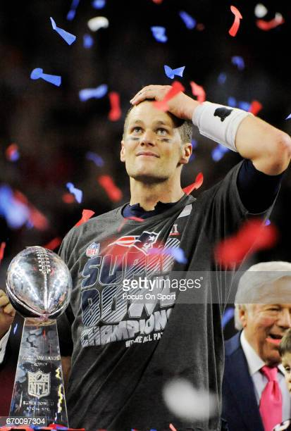 Tom Brady of the New England Patriots celebrates with the Vince Lombardi trophy after the Patriots defeat the Atlanta Falcons 3428 in overtime of...