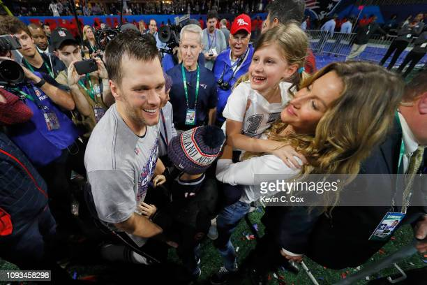 Tom Brady of the New England Patriots celebrates with wife Gisele Bundchen and children Vivian and Benjamin after Super Bowl LIII at MercedesBenz...