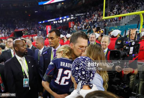 Tom Brady of the New England Patriots celebrates with wife Gisele Bundchen daughter Vivian Brady and mother Galynn Brady after defeating the Atlanta...