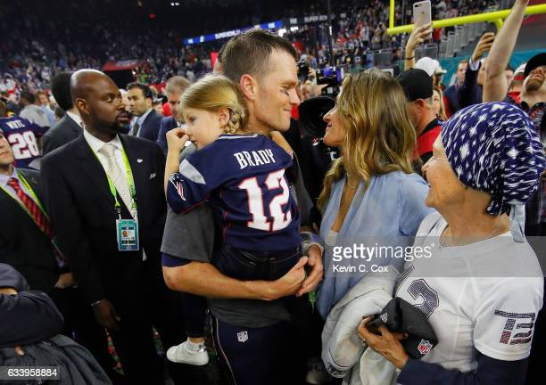 Tom Brady of the New England Patriots celebrates with wife Gisele Bundchen and daughter Vivian Brady after defeating the Atlanta Falcons during Super...