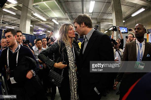 Tom Brady of the New England Patriots chats with his wife Gisele Bundchen speak in the press conference area after the Patriots lost 2117 against the...
