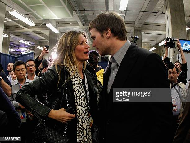 Tom Brady of the New England Patriots chats with his wife Gisele Bundchen after losing to the New York Giants by a score of 2117 in Super Bowl XLVI...