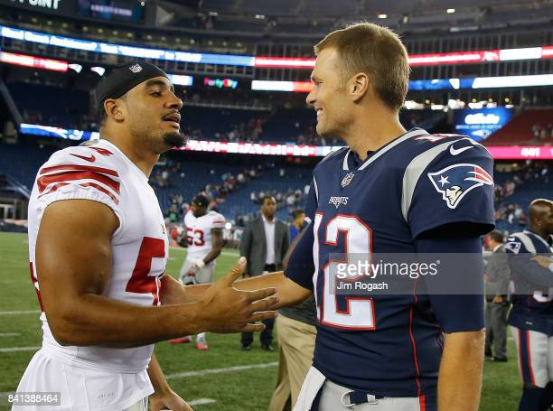 Tom Brady of the New England Patriots chats with Olivier Vernon of the New York Giants after a preseason game at Gillette Stadium on August 31 2017...