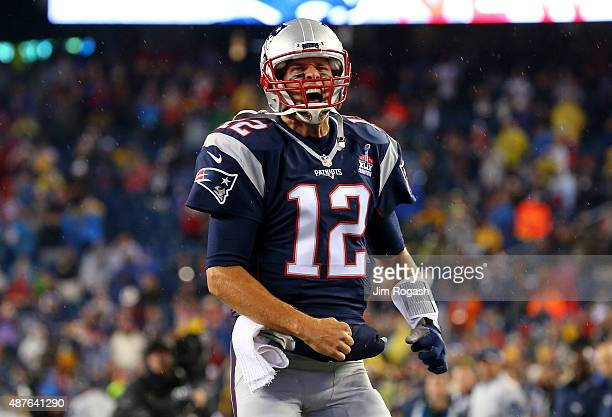 Tom Brady of the New England Patriots cheers as he runs on to the field before the game against the Pittsburgh Steelers at Gillette Stadium on...