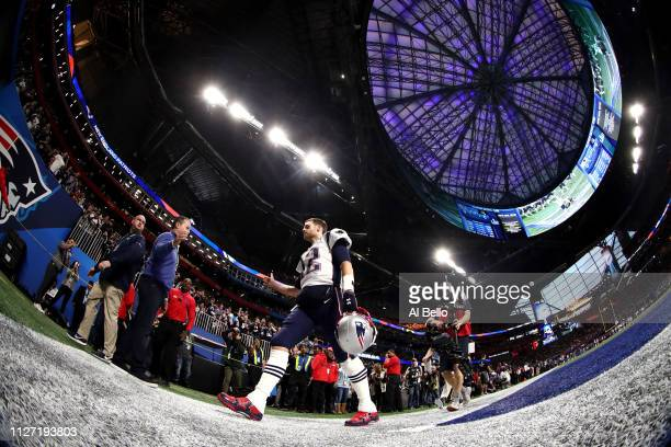 Tom Brady of the New England Patriots comes of the field prior to Super Bowl LIII against the Los Angeles Rams at MercedesBenz Stadium on February 03...