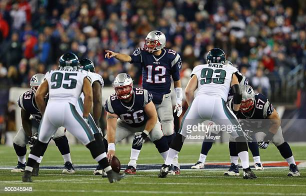 Tom Brady of the New England Patriots communicates at the line of scrimmage during the game against the Philadelphia Eagles at Gillette Stadium on...