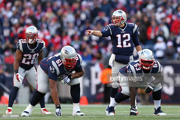 Tom Brady of the New England Patriots communicates at the line of scrimmage during the first half against the Tennessee Titans at Gillette Stadium on...
