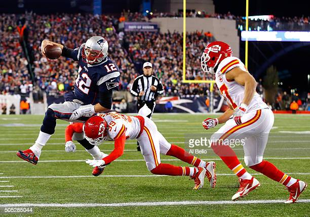 Tom Brady of the New England Patriots dives for the end zone in the second quarter against Husain Abdullah and Tyvon Branch of the Kansas City Chiefs...
