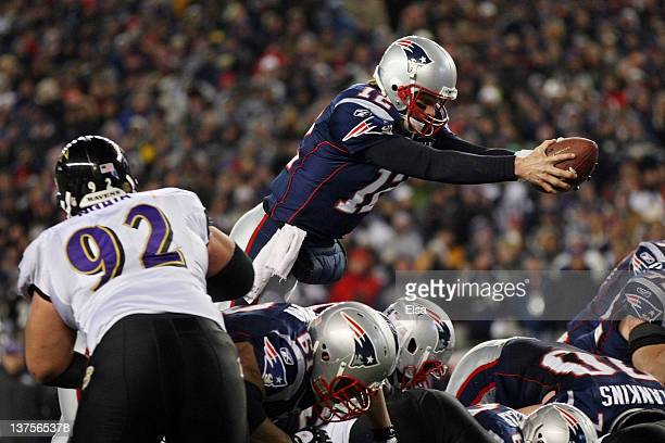Tom Brady of the New England Patriots dives into the end zone to score a touchdown in the fourth quarter against the Baltimore Ravens during their...