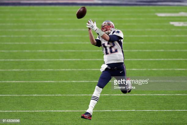 Tom Brady of the New England Patriots drops a pass inteded for him from teammate Rob Gronkowski during the second quarter against the Philadelphia...