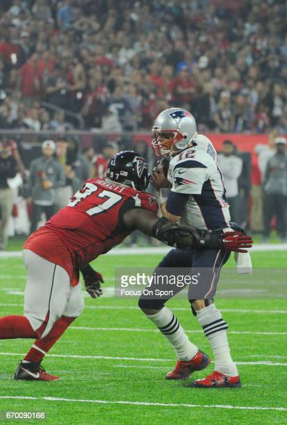 Tom Brady of the New England Patriots drops back to pass under pressure from Grady Jarrett of the Atlanta Falcons during Super Bowl 51 at NRG Stadium...