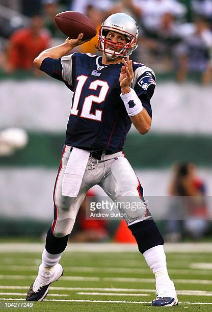 Tom Brady of the New England Patriots drops passes against the New York Jets at the New Meadowlands Stadium on September 19 2010 in East Rutherford...