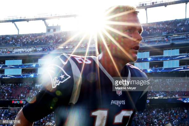 Tom Brady of the New England Patriots exits the field after defeating the Houston Texans 3633 at Gillette Stadium on September 24 2017 in Foxboro...