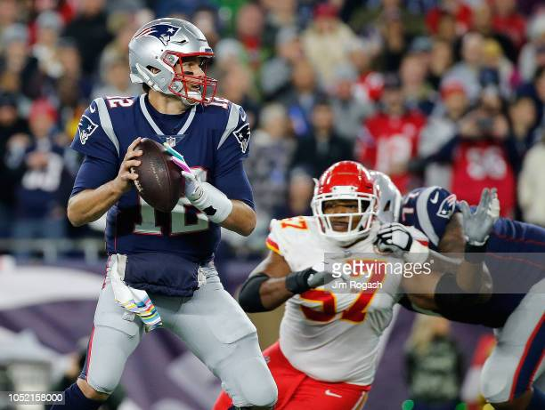 Tom Brady of the New England Patriots feels the pressure of Breeland Speaks of the Kansas City Chiefs in the fourth quarter at Gillette Stadium on...