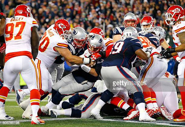 Tom Brady of the New England Patriots fights his way in to the end zone for a touchdown in the second quarter against the Kansas City Chiefs during...