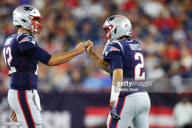 Tom Brady of the New England Patriots fist bumps Brian Hoyer during the preseason game between the Carolina Panthers and the New England Patriots at...