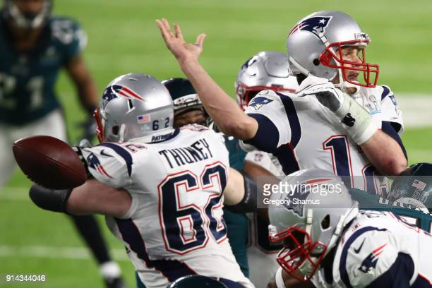 Tom Brady of the New England Patriots fumbles against the Philadelphia Eagles during the fourth quarter in Super Bowl LII at US Bank Stadium on...