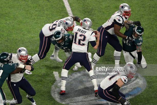 Tom Brady of the New England Patriots fumbles as Brandon Graham of the Philadelphia Eagles strips the ball in the fourth quarter of Super Bowl LII at...