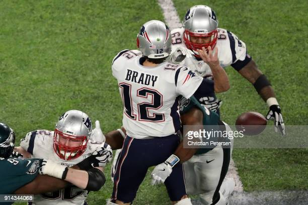 Tom Brady of the New England Patriots fumbles the ball after being sacked by Brandon Graham of the Philadelphia Eagles in the fourth quarter of Super...