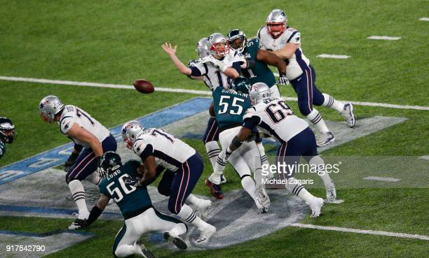 Tom Brady of the New England Patriots fumbles the ball while being sacked by Brandon Graham of the Philadelphia Eagles in Super Bowl LII at US Bank...