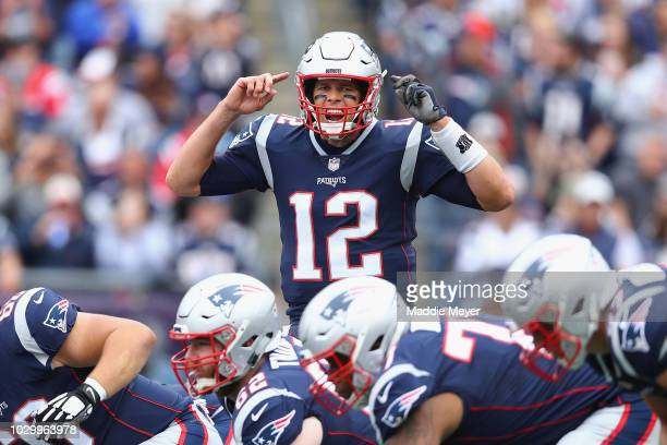 Tom Brady of the New England Patriots gestures at the line of scrimmage during the first half against the Houston Texans at Gillette Stadium on...
