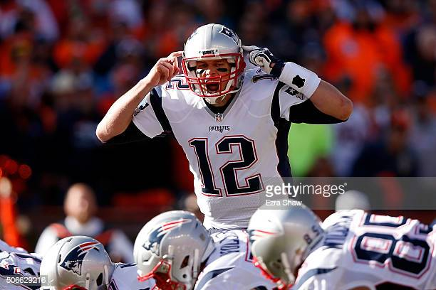 Tom Brady of the New England Patriots gestures at the line of scrimmage in the first quarter against the Denver Broncos in the AFC Championship game...