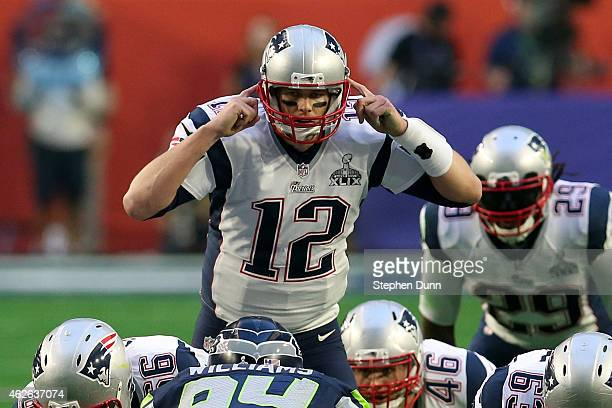 Tom Brady of the New England Patriots gestures before the snap in the first quarter against the Seattle Seahawks during Super Bowl XLIX at University...