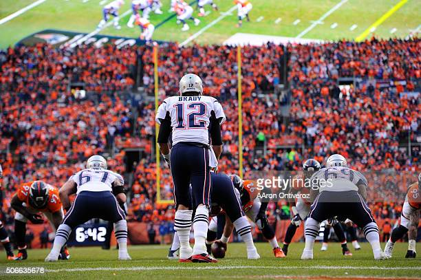 Tom Brady of the New England Patriots gets ready for the snap at the line of scrimmage in the third quarter The Denver Broncos played the New England...