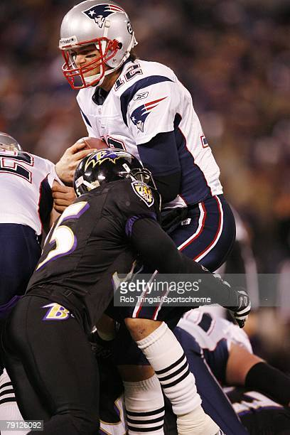 Tom Brady of the New England Patriots gets tackled by Terrell Suggs of the Baltimore Ravens on December 3 2007 at MT Bank Stadium in Baltimore...