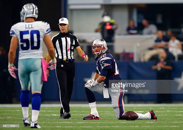 Tom Brady of the New England Patriots gets up after being sacked as Sean Lee of the Dallas Cowboys is near during the first half of the NFL game at...