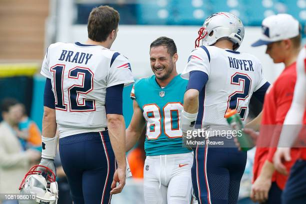 Tom Brady of the New England Patriots greets Danny Amendola of the Miami Dolphins prior to the game at Hard Rock Stadium on December 9 2018 in Miami...