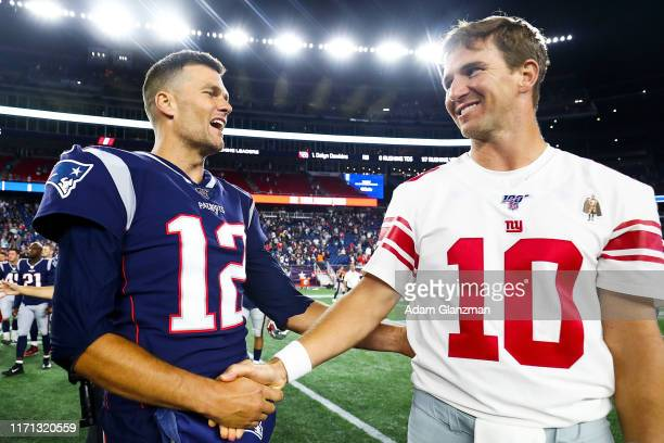 Tom Brady of the New England Patriots greets Eli Manning of the New York Giants after a preseason game at Gillette Stadium on August 29, 2019 in...