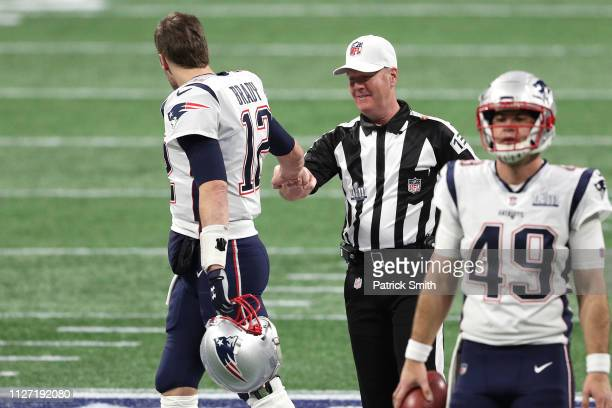 Tom Brady of the New England Patriots greets referee John Parry prior to Super Bowl LIII against Los Angeles Rams at MercedesBenz Stadium on February...