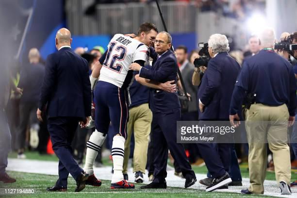 Tom Brady of the New England Patriots greets team president Jonathan Kraft prior to Super Bowl LIII against the Los Angeles Rams at MercedesBenz...