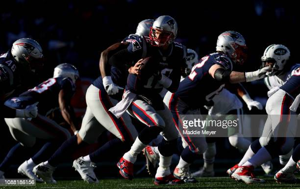 Tom Brady of the New England Patriots hands off the ball during the first quarter of a game against the New York Jets at Gillette Stadium on December...
