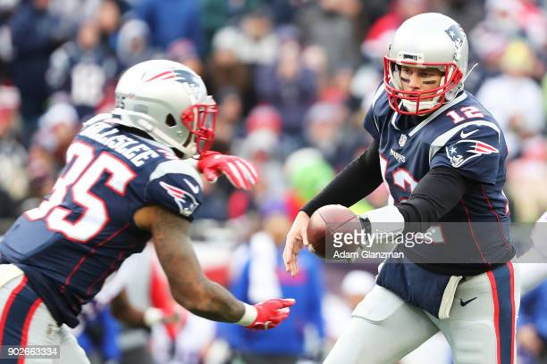 Tom Brady of the New England Patriots hands off the ball to Mike Gillislee during a game against the Buffalo Bills at Gillette Stadium on December...